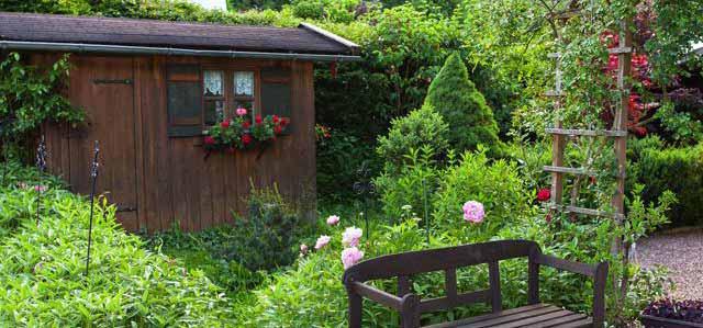 Garten der Ferienwohnungen Grill im Sommer